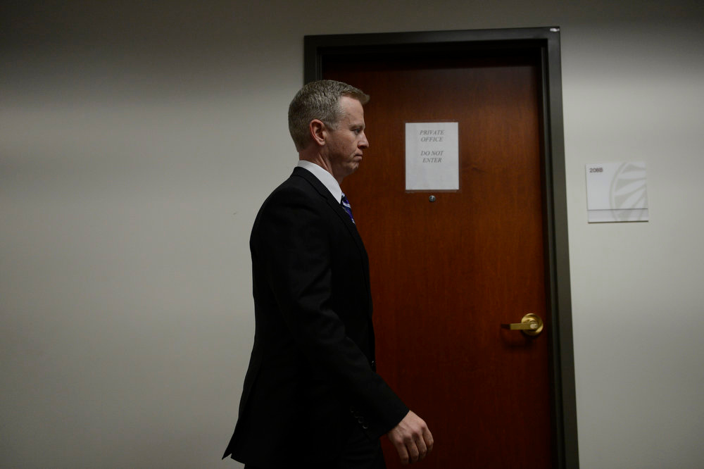 Description of . District Attorney George Brauchler heads back into district court for a hearing in the case of Aurora theater shooting suspect James Holmes in Centennial, Monday April 01, 2013. The prosecution will go for the death penalty against the Aurora theater shooting suspect James Holmes. (Photo By RJ Sangosti/The Denver Post)