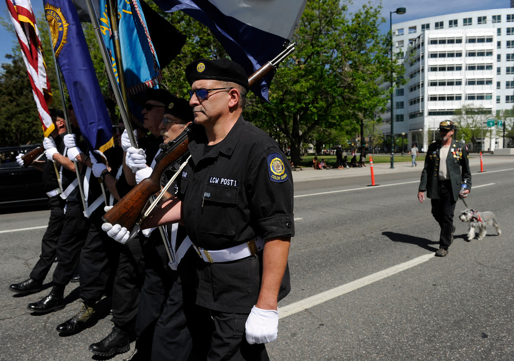 . Members of The American Legion LCW Post 1 Color Guard make their way down Broadway.  (Photo By Kathryn Scott Osler/The Denver Post)