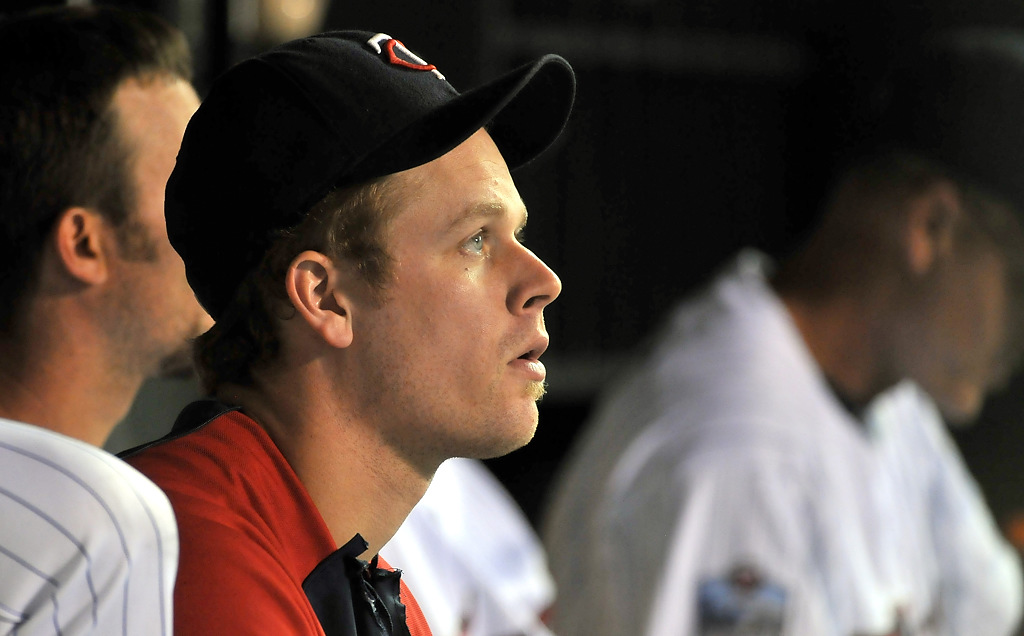 . Twins first baseman Justin Morneau sits in the dugout while Twins take on the Chicago White Sox at Target Field, Tuesday, August 17, 2010. (Pioneer Press: John Autey)