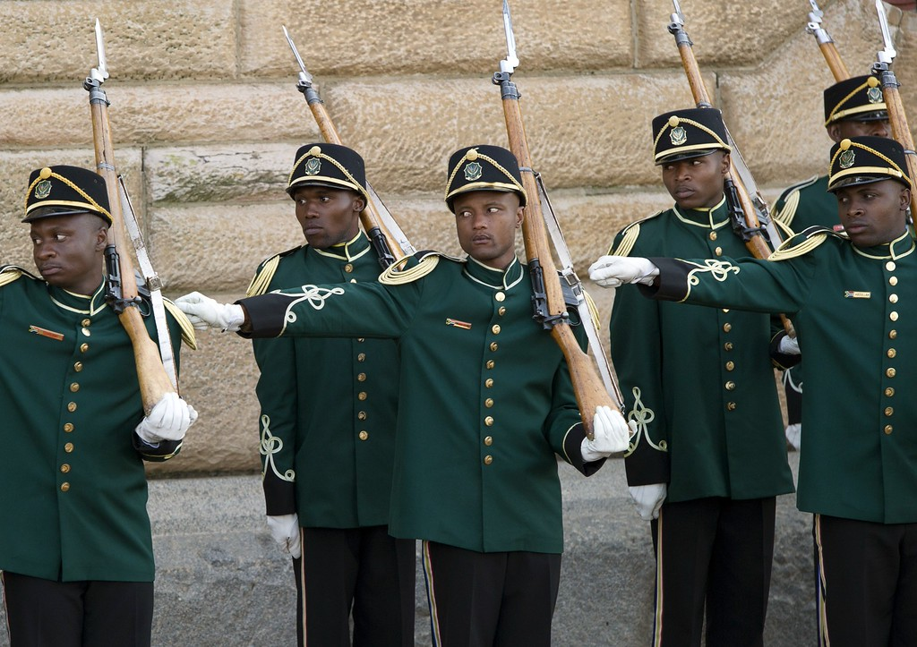 """. An honor guard lines up for the arrival of US President and First Lady for meetings with South African President at the Union Building in Pretoria, South Africa, on June 29, 2013. US President Barack Obama will not visit his political hero Nelson Mandela in hospital, out of deference for the anti-apartheid icon\'s \""""peace and comfort,\"""" a US official said today. Obama and his wife Michelle will however spend time with Mandela\'s family to comfort them in a difficult time, the official said, as the US leader arrived in Pretoria for talks with President Jacob Zuma. SAUL LOEB/AFP/Getty Images"""