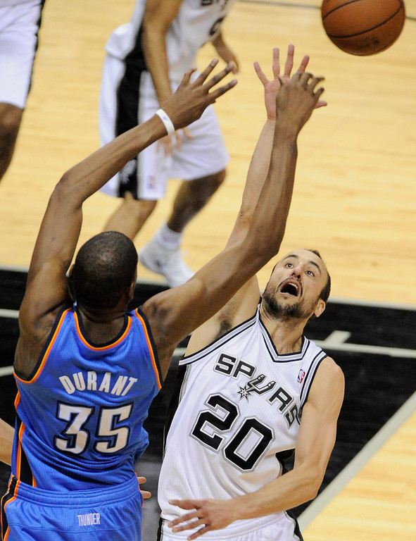 . San Antonio Spurs guard Manu Ginobili, right, of Argentina, defends Oklahoma City Thunder forward Kevin Durant during the second half of Game 2 of a Western Conference finals NBA basketball playoff series, Wednesday, May 21, 2014, in San Antonio. San Antonio won 112-77. (AP Photo/Darren Abate)