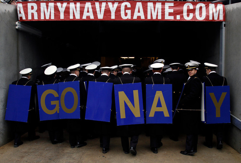 . Navy Midshipmen march off the field before the start of the 113th Army-Navy football game in Philadelphia Saturday Dec. 8, 2012. (AP Photo/Jacqueline Larma)