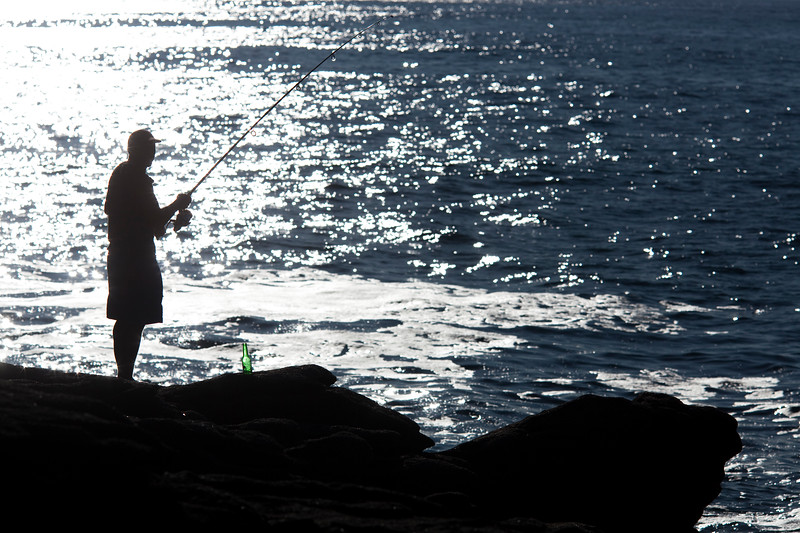 Man fishing, Cote Sauvage (Wild Coast), Quiberon, departament de Morbihan, Brittany, France