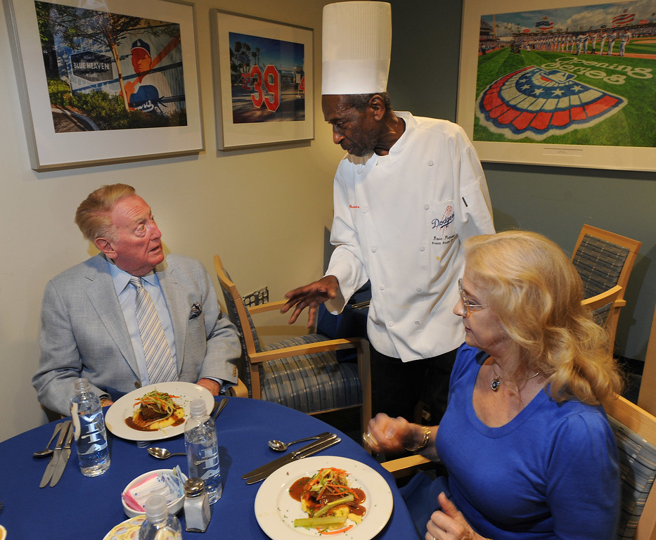 . Dave Pearson serves up a meal for Vin and Sandy Scully. Pearson has been cooking up meals in the Dodger Press box for many years.  Los Angeles, CA. 8/19/2014(Photo by John McCoy Daily News)