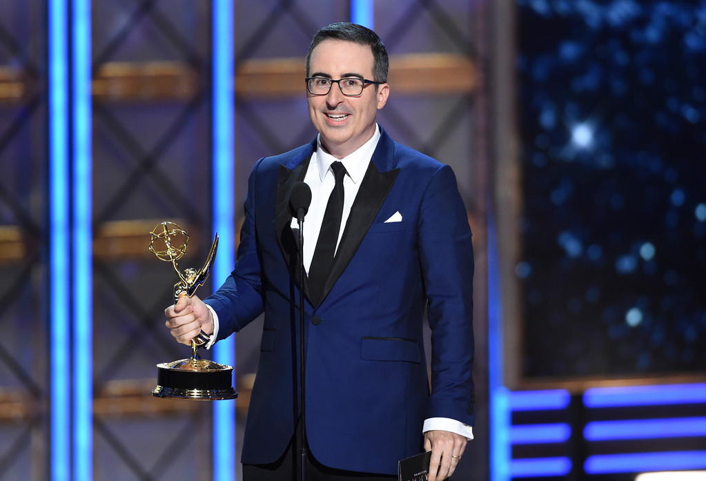 ". John Oliver accepts the award for outstanding writing for a variety series for ""Last Week Tonight with John Oliver\"" at the 69th Primetime Emmy Awards on Sunday, Sept. 17, 2017, at the Microsoft Theater in Los Angeles. (Photo by Phil McCarten/Invision for the Television Academy/AP Images)"