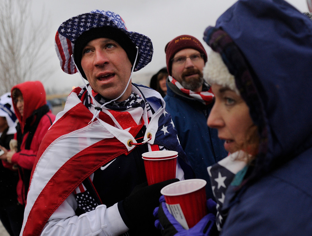 . COMMERCE CITY, CO. - MARCH 22: Jim Mazzitelli, left, and Kristi Tanner, right, waited for the gates to open for the game Friday night. The U.S. Men\'s National Soccer Team hosted Costa Rica Friday night, March 22, 2013 in a FIFA World Cup qualifier at Dick\'s Sporting Goods Park in Commerce City.  (Photo By Karl Gehring/The Denver Post)
