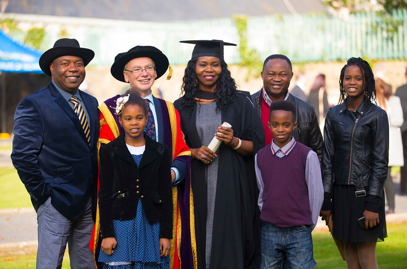 02/11/2016. Waterford Institute of Technology (WIT) Conferring Ceremonies November 2016. Pictured with Prof. Willie Donnelly President of WIT is Laura Igwe from Waterford who graduated with a B.A. (Hons) in Applied Social Studies in Social Care, also pictured are her family Frank, Petra, David Paula and Henry. Picture: Patrick Browne
