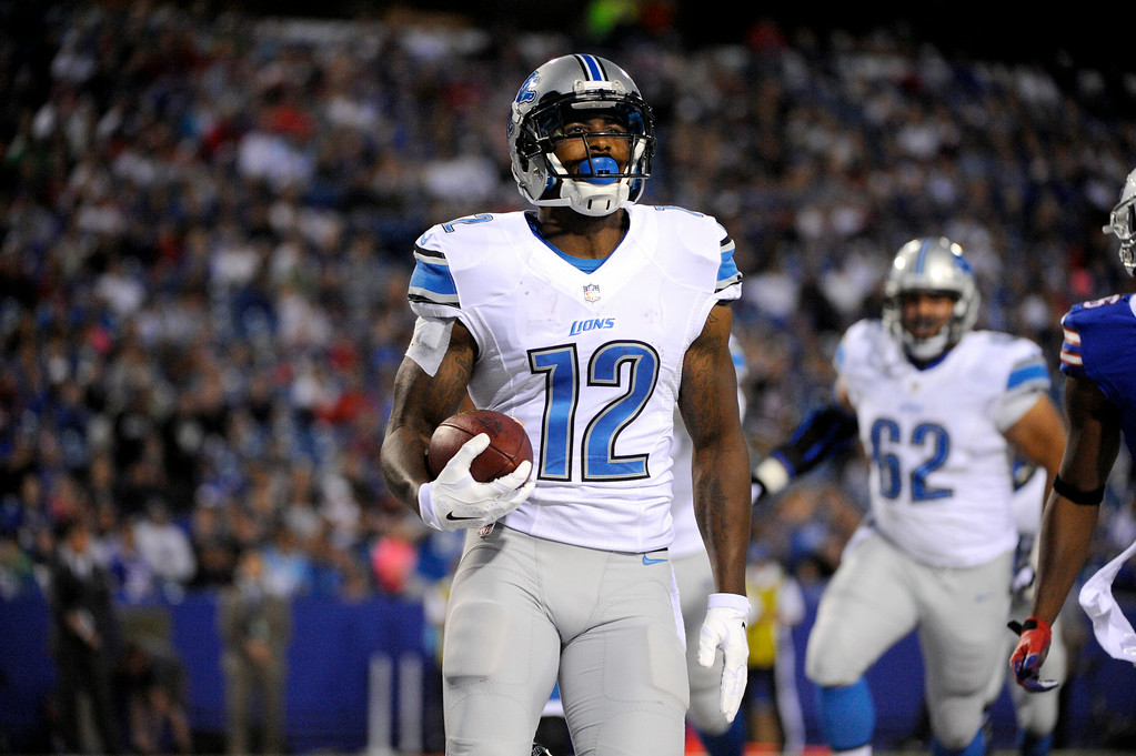 . Detroit Lions wide receiver Jeremy Ross scores on a touchdown pass from quarterback Kellen Moore during the first half of a preseason NFL football game against the Buffalo Bills, Thursday, Aug. 28, 2014, in Orchard Park, N.Y. (AP Photo/Gary Wiepert)