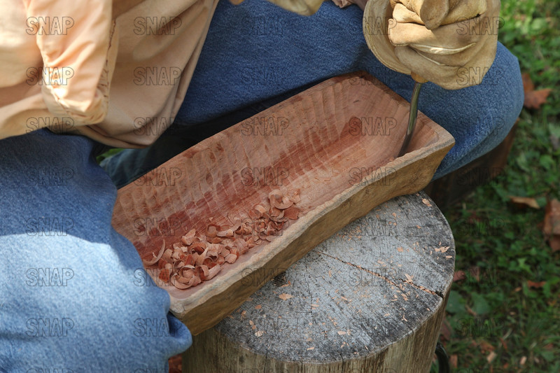 Jeff Wilkinson from Terre Haute, IN, carving a bowl from cherry wood, at the Pioneer Days festival, in Fowler Park, near Terre Haute, IN.