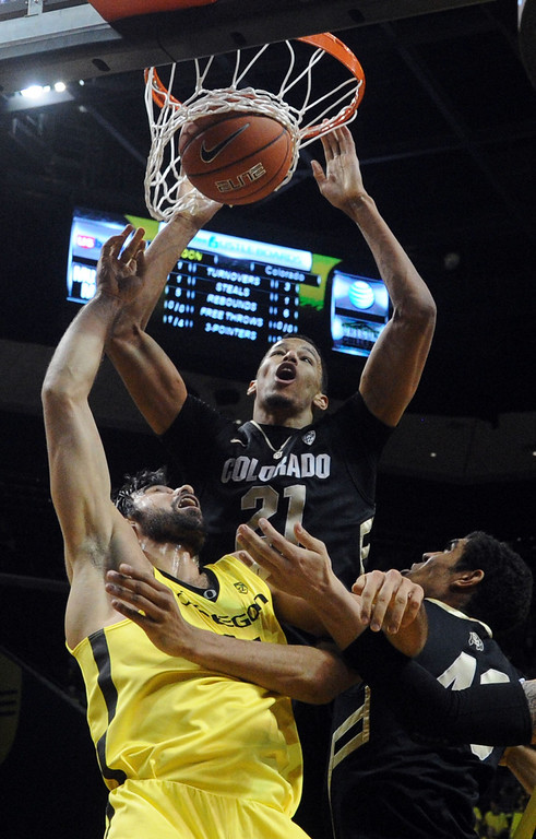 . Andre Roberson #21 of the Colorado Buffaloes dunks the ball on Arsalan Kazemi #14 of the Oregon Ducks  in the first half of the game  at Matthew Knight Arena on February 7, 2013 in Eugene, Oregon. (Photo by Steve Dykes/Getty Images)