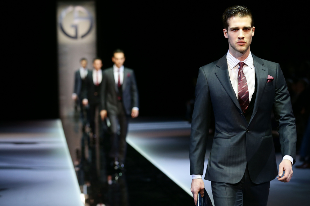Description of . Models walk the runway during the Giorgio Armani show as part of Milan Fashion Week Menswear Autumn/Winter 2013 on January 15, 2013 in Milan, Italy.  (Photo by Vittorio Zunino Celotto/Getty Images)