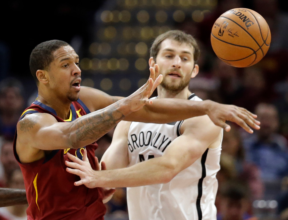 . Cleveland Cavaliers\' Channing Frye, left, passes against Brooklyn Nets\' Tyler Zeller (44) in the first half of an NBA basketball game, Wednesday, Nov. 22, 2017, in Cleveland. (AP Photo/Tony Dejak)