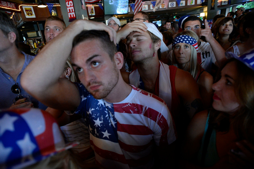 . Fans react after Belgium\'s second goal in extra time against he USA as they watch at The Three Lions July 1, 2014 to watch the United States take on Belgium in the World Cup. (Photo by John Leyba/The Denver Post)