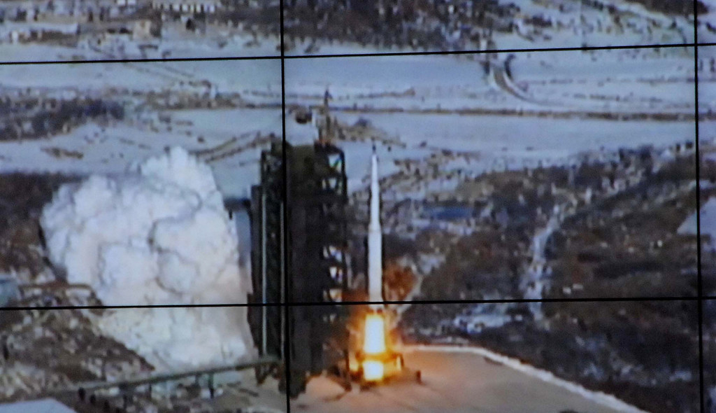 . In this monitor screen image taken and released by the Korean Central News Agency and distributed in Tokyo by the Korea News Service, the Unha-3 rocket lifts off from a launch site on the west coast, in the village of Tongchang-ri, about 56 kilometers (35 miles) from the Chinese border city of Dandong, North Korea, Wednesday, Dec. 12, 2012. North Korea successfully fired a long-range rocket on Wednesday. (AP Photo/Korea Central News Agency via Korea News Service)