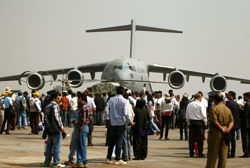 . Visitors crowd near a U.S. Air Force C-17 Globemaster, a transport aircraft, on display on the second day of the Aero India 2013 at Yelahanka air base in Bangalore, India, Thursday, Feb. 7, 2013. More than 600 aviation companies along with delegations from 78 countries are participating in the five-day event that started Wednesday. (AP Photo/Aijaz Rahi)