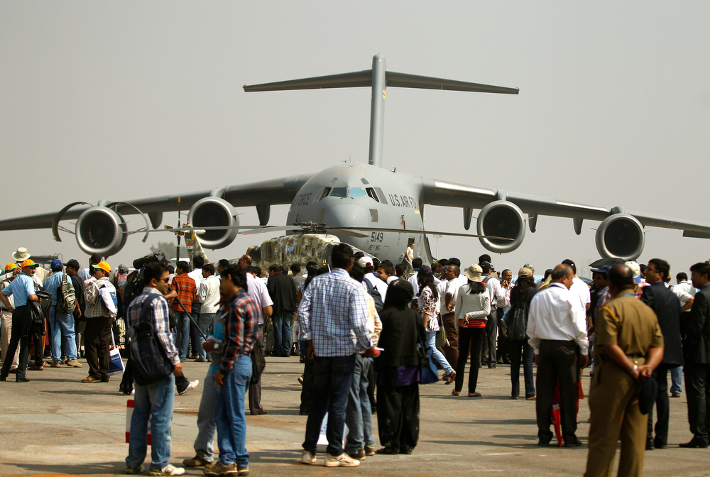 Description of . Visitors crowd near a U.S. Air Force C-17 Globemaster, a transport aircraft, on display on the second day of the Aero India 2013 at Yelahanka air base in Bangalore, India, Thursday, Feb. 7, 2013. More than 600 aviation companies along with delegations from 78 countries are participating in the five-day event that started Wednesday. (AP Photo/Aijaz Rahi)