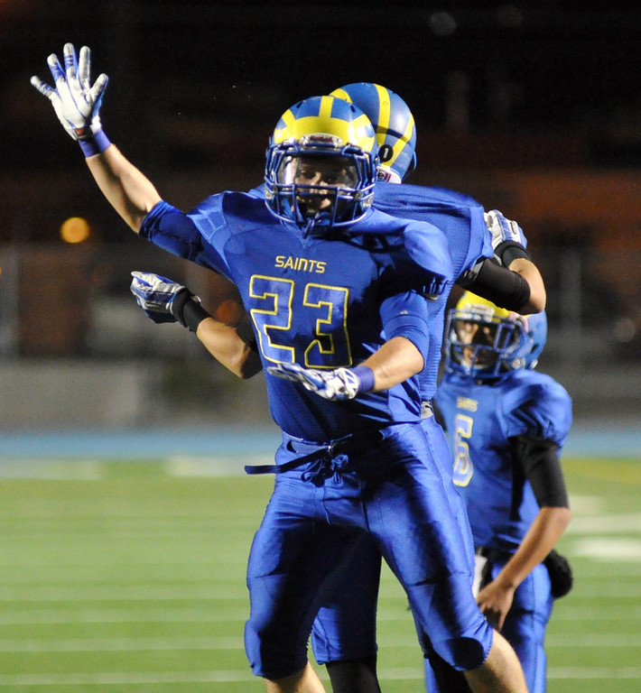 . San Dimas running back Joseph Mayorga (#23) celebrates scoring a touchdown as they play Pomona in their Valley Vista League football game at San Dimas High School on November 8, 2013. San Dimas defeated Pomona 49-6. (San Gabriel Valley Tribune/Staff Photo by Keith Durflinger)