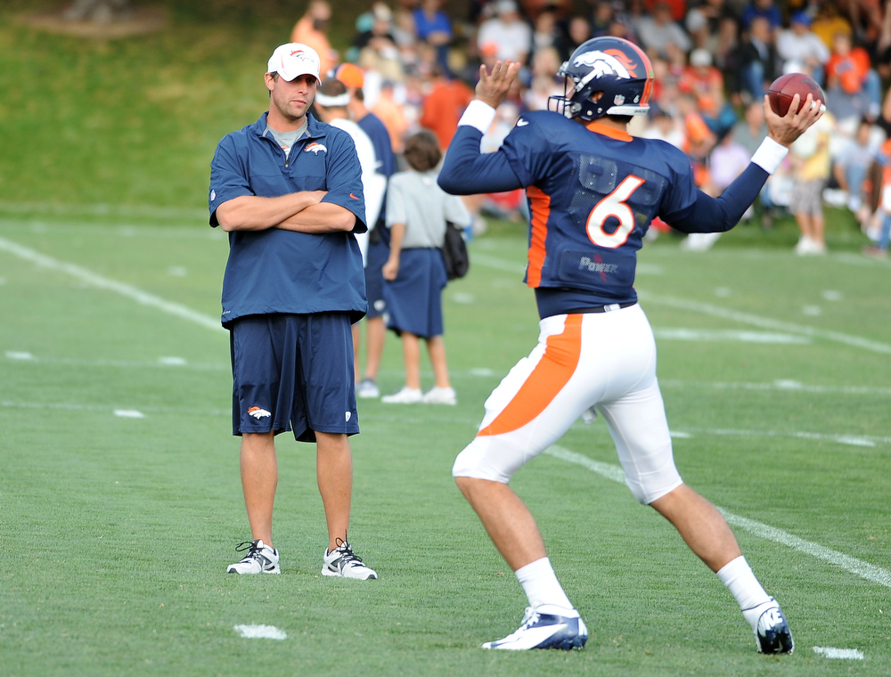 . Broncos quarterback Brock Osweiler works on throwing mechanics for quarterbacks coach Adam Gase at the beginning of practice Thursday morning, August 16, 2012. Steve Nehf, The Denver Post