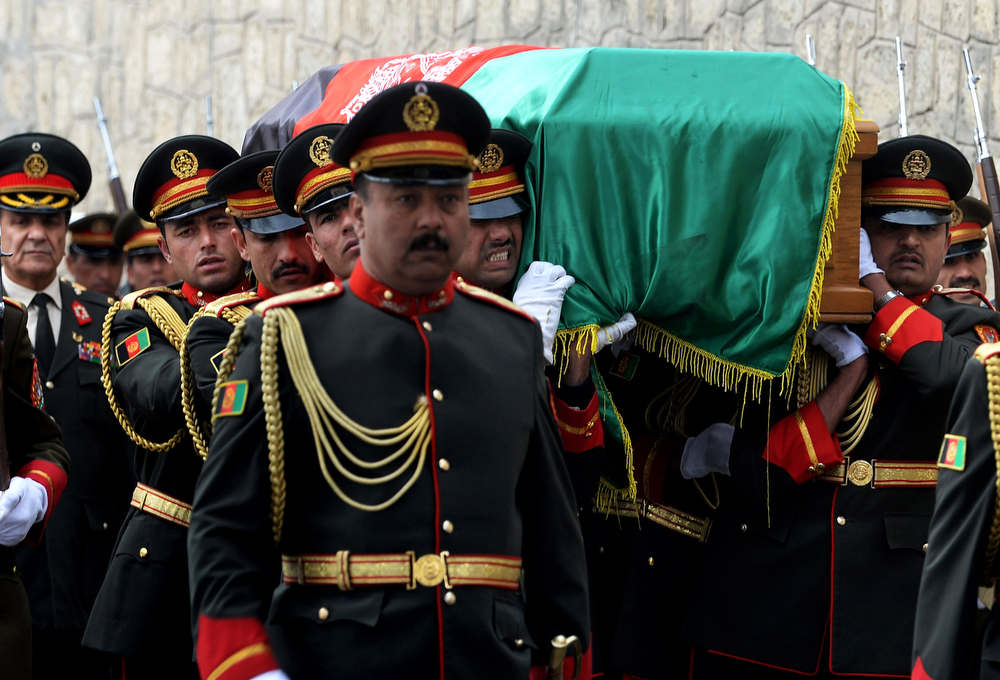 . Afghan honor guards carry the coffin of Afghanistan\'s influential Vice President Mohammad Qasim Fahim during his funeral procession in Kabul, Afghanistan, Tuesday, March 11, 2014. Fahim, a leading commander in the alliance that fought the Taliban who was later accused with other warlords of targeting civilian areas during the country\'s civil war, died on Sunday, March 9, 2014. He was 57. (AP Photo/Shah Marai, Pool)