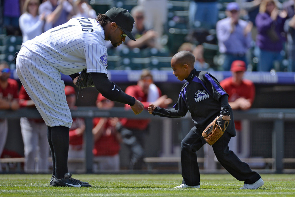. DENVER, CO. - APRIL 21: Dallas Young 6-years-old fist bumps his brother Eric Young Jr. after throwing out the first pitch prior to their game against the Arizona DiamondBacks April 21, 2013 at Coors Field. (Photo By John Leyba/The Denver Post)