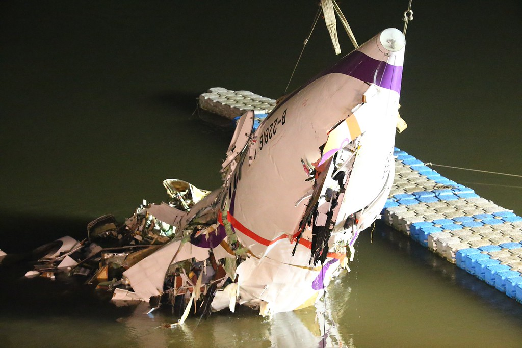 . The mangled fuselage of a TransAsia Airways commercial plane is dragged to the river bank after it crashed in Taipei, Taiwan, Wednesday, Feb. 4, 2015. The Taiwanese commercial flight with 58 people aboard clipped a bridge shortly after takeoff and crashed into a river in the island\'s capital of Taipei on Wednesday morning. (AP Photo)