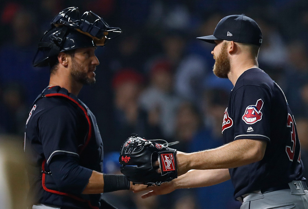 . Cleveland Indians\' Cody Allen, right, and Yan Gomes celebrate the team\'s 1-0 win in a baseball game against the Chicago Cubs on Wednesday, May 23, 2018, in Chicago. (AP Photo/Jim Young)
