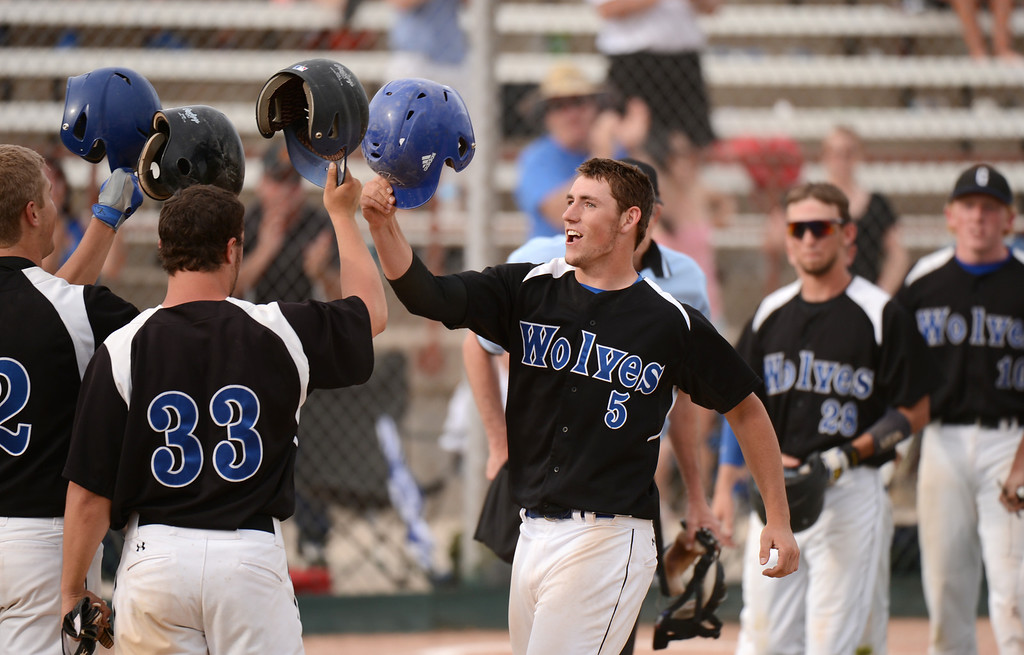 . DENVER, CO. - MAY 17 : Josh Huntley of Grandview High School (5) celebrates his home run with his teammates during the 5A playoff game against Rocky Mountain High School at All City Field. Denver, Colorado. Grandview won 9-2. May 17, 2013. (Photo By Hyoung Chang/The Denver Post)