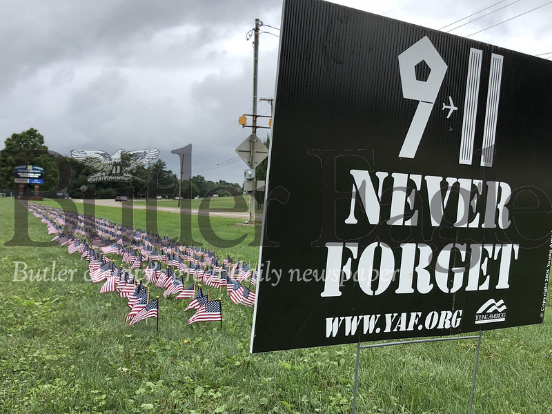 Students and members of the Mars School District community placed 2,977 flags in front of Mars High School in honor of those who lost their lives in the Sept. 11 attacks.