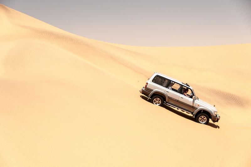 Driving through sand dunes in Namib Desert