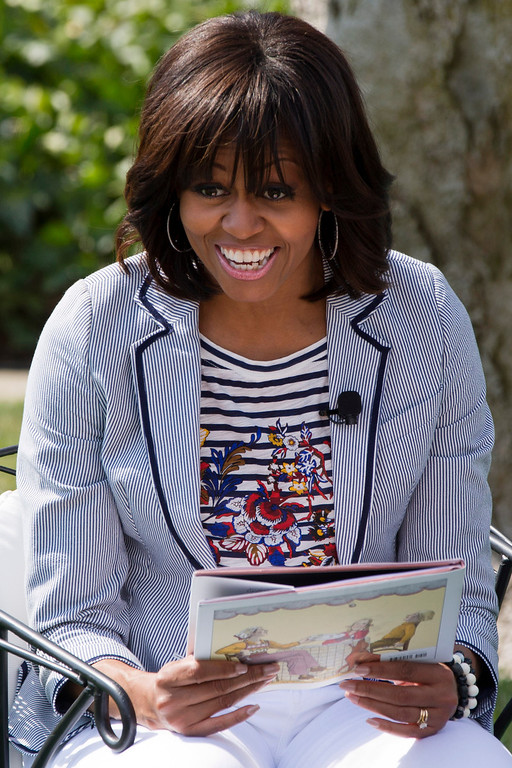 ". First lady Michelle Obama smiles before reading the book ""Cloudy With A Chance of Meatballs\"" as part of the annual White House Easter Egg Roll, Monday, April 1, 2013,  on the South Lawn of the White House in Washington. (AP Photo/Jacquelyn Martin)"