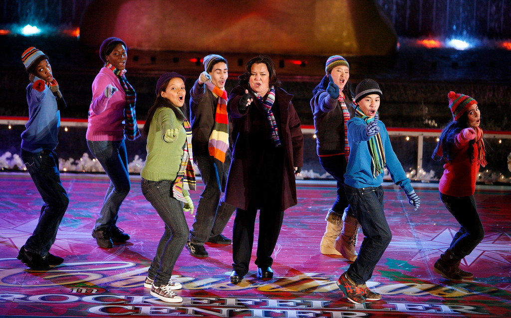 . Actress Rosie O\'Donnell performs with The Broadway Kids during the 76th annual Rockefeller Center Christmas tree lighting ceremony Wednesday, Dec. 3, 2008, in New York.  (AP Photo/Jason DeCrow)