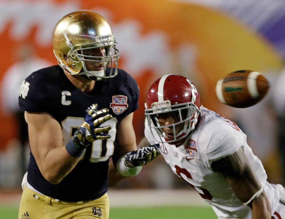 . Notre Dame\'s Tyler Eifert (80) catches a pass in front of Alabama\'s Ha\'Sean Clinton-Dix (6) during the second half of the BCS National Championship college football game Monday, Jan. 7, 2013, in Miami. (AP Photo/Chris O\'Meara)