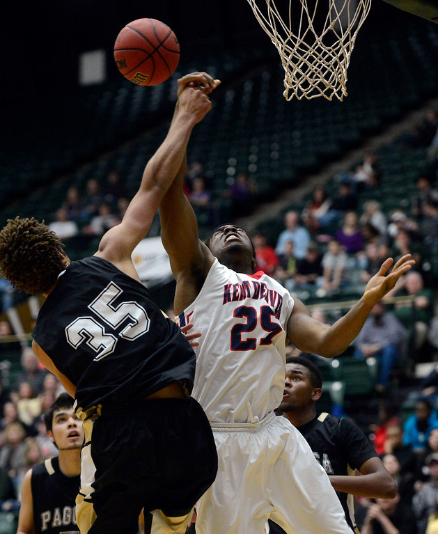 . FT. COLLINS, CO. - MARCH 16TH: Brannon Jones, Kent Denver, right, and DeAngelo Guthrie, Pagosa Springs, battle for possession of the ball in the first half of play for the boys 3A Colorado State Championship at Moby Arena in Ft. Collins Saturday evening. (Photo By Andy Cross/The Denver Post)