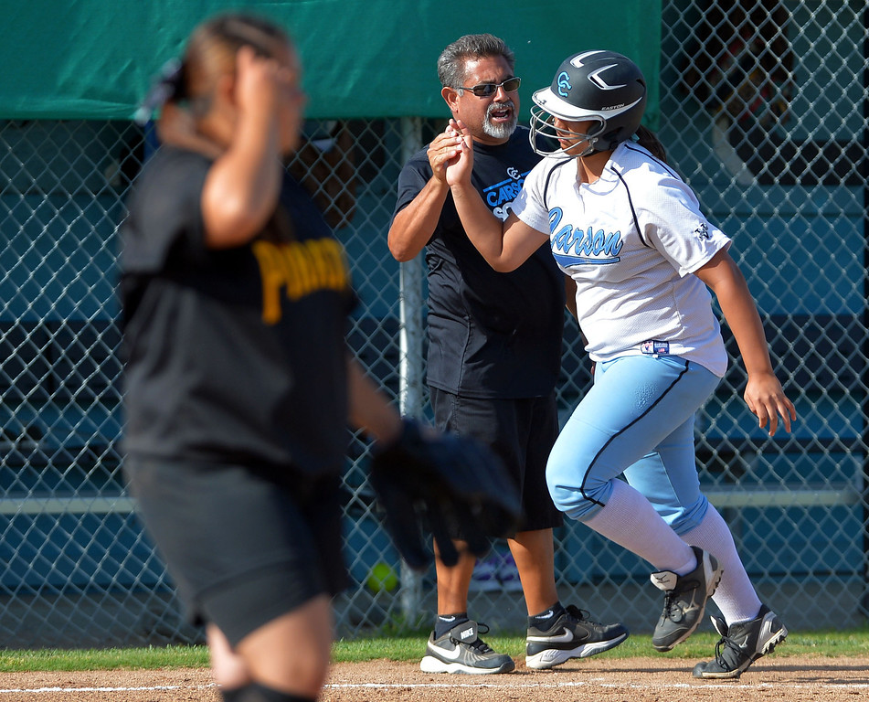 . 0522_SPT_TDB-L-SP-CARSON --Carson, California Daily Breeze Staff Photo: Robert Casillas / LANG Carson HS defeated Marine League rival San Pedro 6-0 in Los Angeles City softball semi-final. Carson assistant coach Ed Nabayan greets Aniesa Maulupe as she rounds third after crushing pitch from Jaclyn Rivera for grand slam.