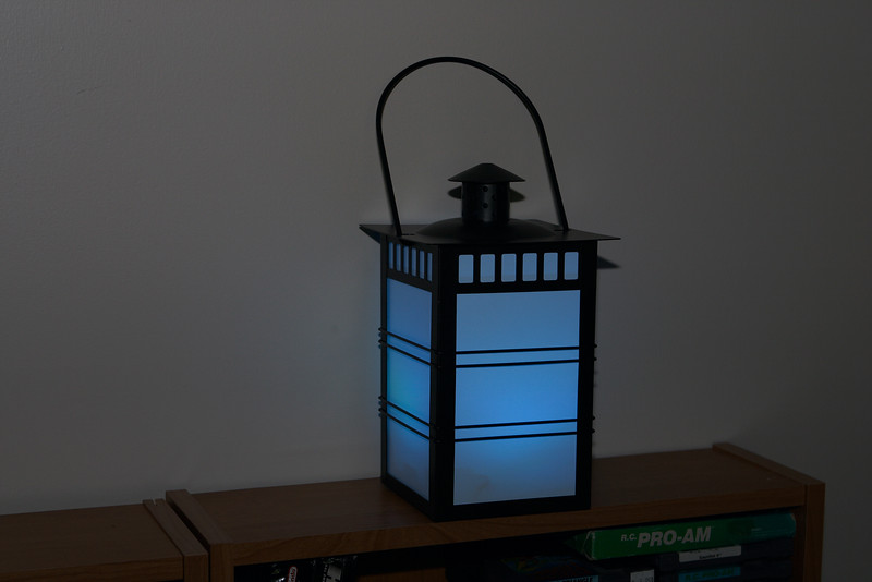 Glows different colors, connected wirelessly to computer upstairs so it can receive information about the weather, etc and vary its color in response