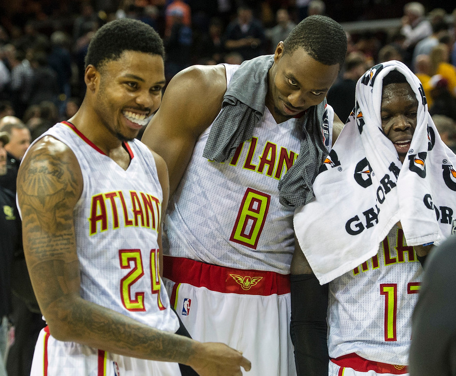 . Atlanta Hawks\' Kent Bazemore (24), Dwight Howard (8) and Dennis Schroder (17) fool around after defeating the Cleveland Cavaliers 110-106 in an NBA basketball game in Cleveland, Tuesday, Nov. 8, 2016. (AP Photo/Phil Long)