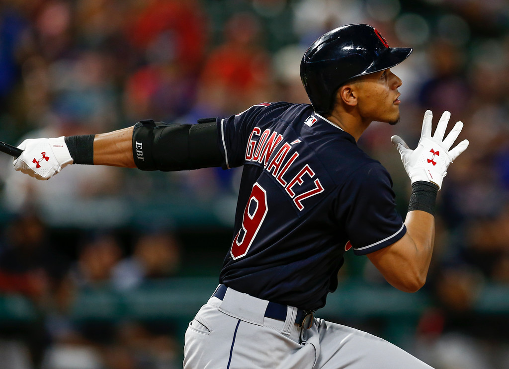 . Cleveland Indians\' Erik Gonzalez follows through on his RBI-double against the Texas Rangers during the ninth inning of a baseball game, Saturday, July 21, 2018, in Arlington, Texas. (AP Photo/Jim Cowsert)
