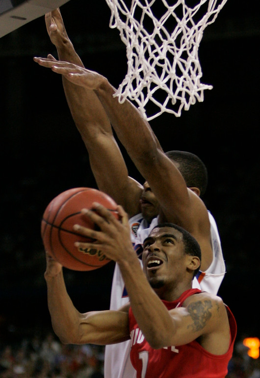 . Florida\'s Al Horford blocks a shot by Ohio State guard Mike Conley Jr. (1) during the second half of the Final Four basketball championship game at Georgia Dome in Atlanta, Monday, April 2, 2007. (AP Photo/Eric Gay)