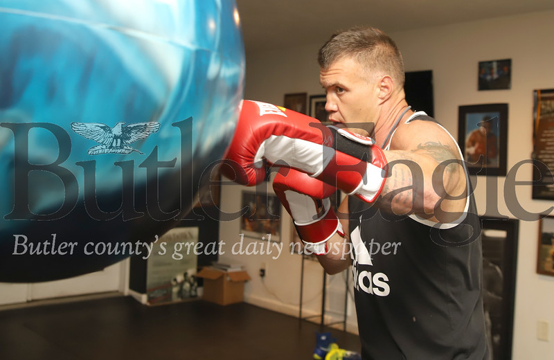 Former boxer Brian Minto warms up with a punching drill in his home gym Tuesday. Seb Foltz/Butler Eagle 06/23/20