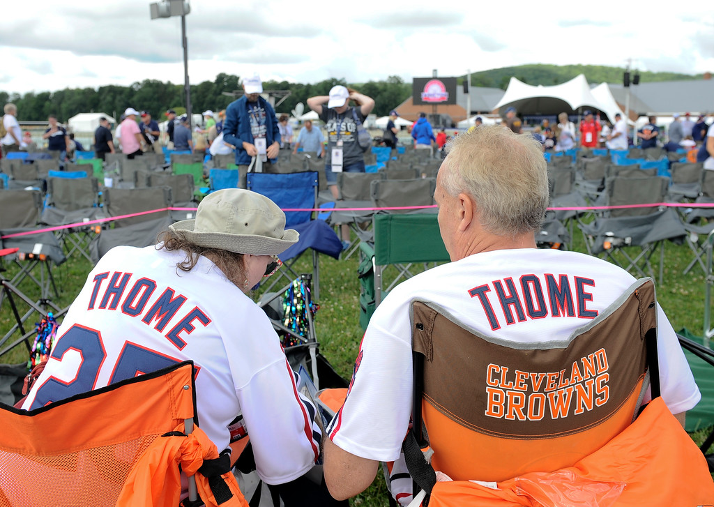 . Jim Thome fans Betsy Yolchim, left, and her husband Tomm Betsy, of Erie, Pa., wait for the start of National Baseball Hall of Fame induction ceremonies Sunday, July 29, 2018, in Cooperstown, N.Y. (AP Photo/Hans Pennink)