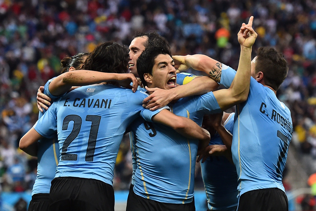 . Uruguay\'s forward Luis Suarez (C) celebrates scoring with teammates during the Group D football match between Uruguay and England at the Corinthians Arena in Sao Paulo on June 19, 2014, during the 2014 FIFA World Cup.   BEN STANSALL/AFP/Getty Images