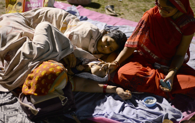 . Indian residents rest and sleep in a football field in Siliguri on April 26, 2015 after a 7.8 magnitude earthquake hit the region on April 25 in Nepal. International aid groups and governments intensified efforts to get rescuers and supplies into earthquake-hit Nepal on April 26, but severed communications and landslides in the Himalayan nation posed formidable challenges to the relief effort. DIPTENDU DUTTA/AFP/Getty Images