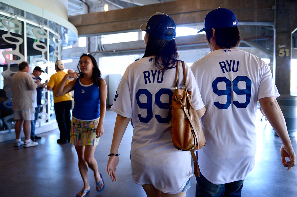 . Sunhee Chun, 28, and her boyfriend Sungmin Boo, 29, both of Torrance, shop before the Dodgers vs Brave\'s game 3 of the NLDS at Dodger Stadium, Sunday, October 6, 2013. (Photo by Sarah Reingewirtz/Los Angeles Daily News)