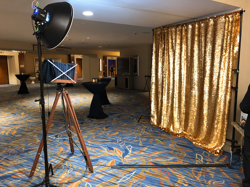 Wood Camera Photo Booth with Gold Sequin Backdrop.jpeg