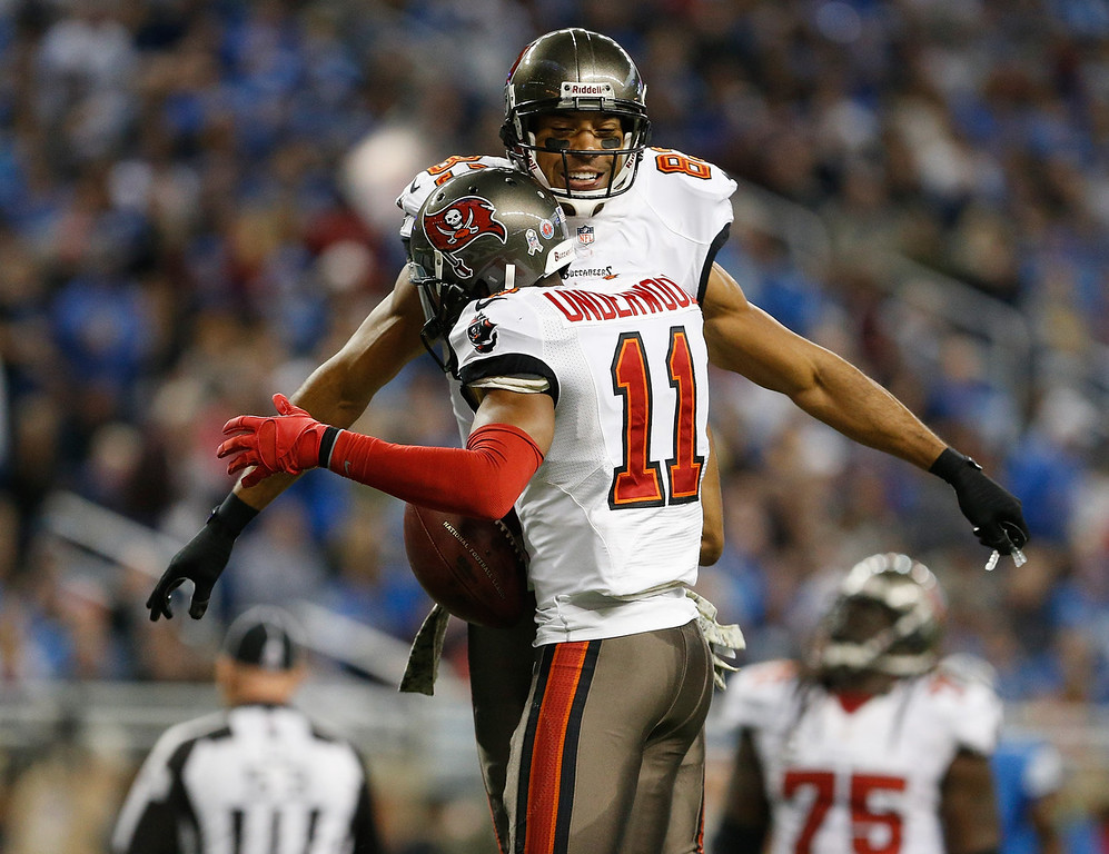 . Tiquan Underwood #11 of the Tampa Bay Buccaneers celebrates a second quarter touchdown catch with Vincent Jackson #83 against the Detroit Lions at Ford Field on November 24, 2013 in Detroit, Michigan. (Photo by Gregory Shamus/Getty Images)