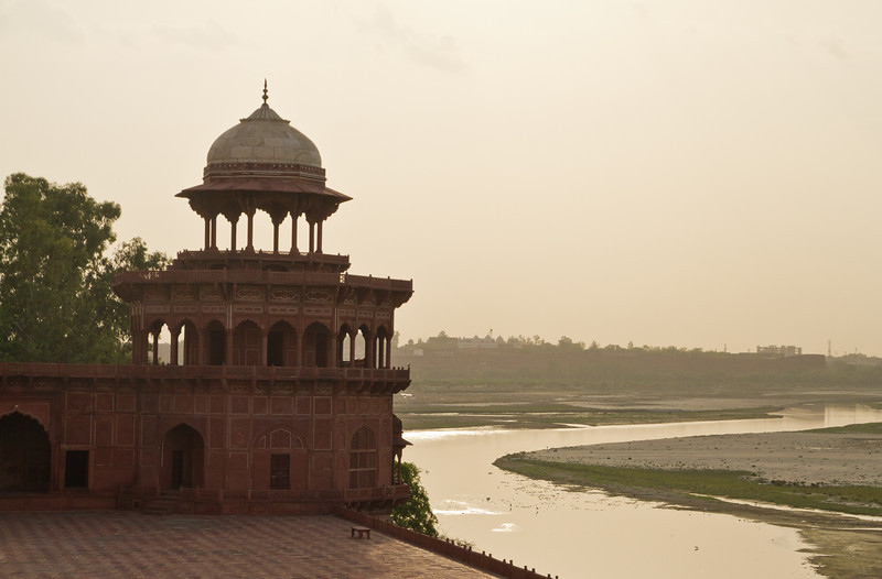 One of the mosques by the side of the Taj and the Yamuna river. Agra Fort in the distance.