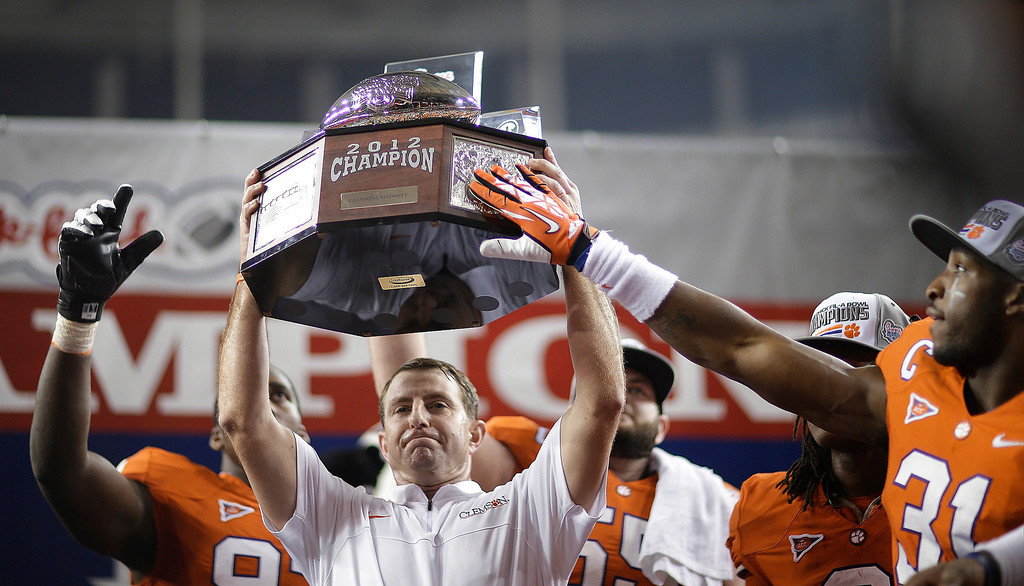 . Clemson coach Dabo Swinney holds the trophy after Clemson defeated LSU 25-24 in the Chick-fil-A Bowl NCAA college football game, Monday, Dec. 31, 2012, in Atlanta. (AP Photo/David Goldman)