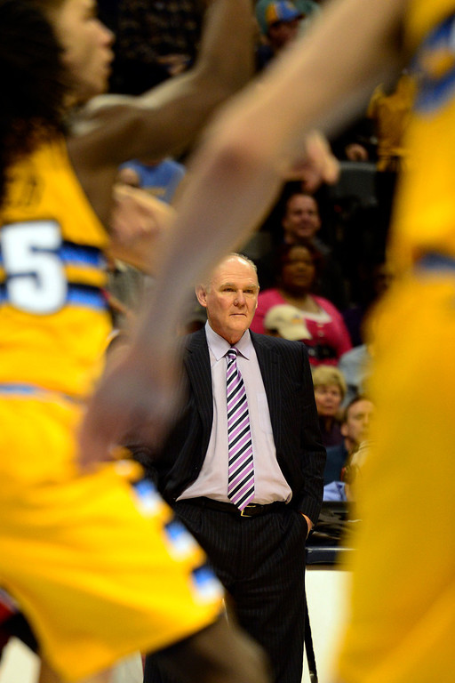 . Denver Nuggets head coach George Karl watches the action during the second half of the Nugget\'s 92-78 win at the Pepsi Center on Tuesday, January 1, 2013. AAron Ontiveroz, The Denver Post