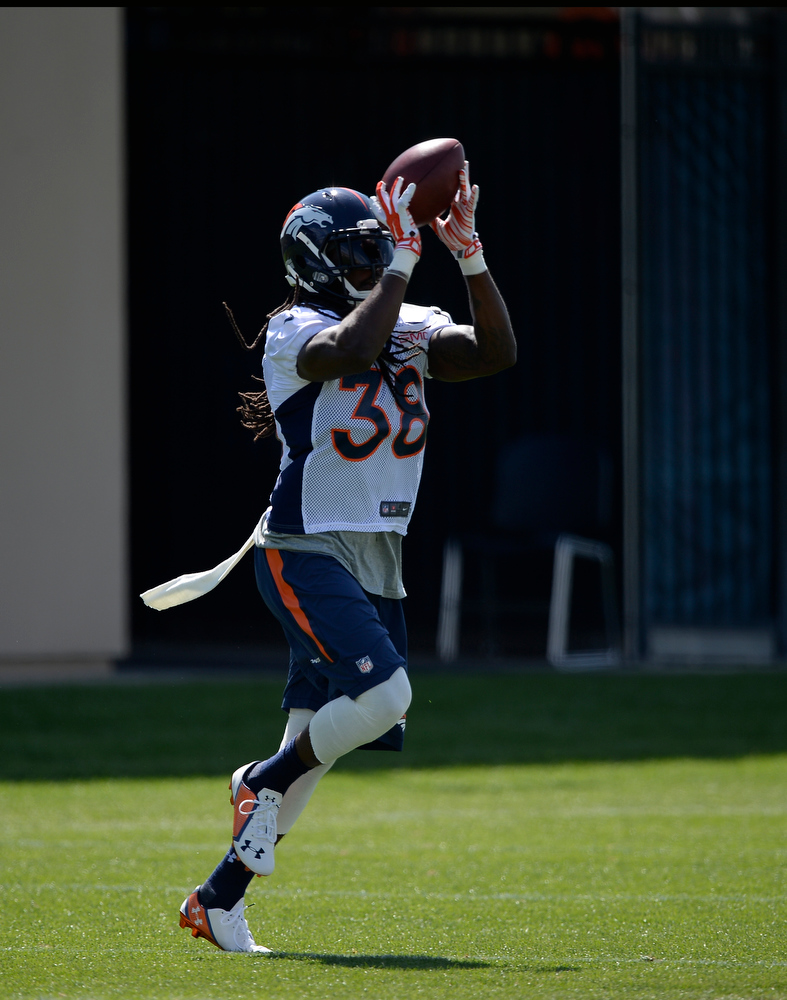 . Denver Broncos strong safety Quinton Carter (38) catches a pass during practice August 25, 2014 at Dove Valley.(Photo by John Leyba/The Denver Post)