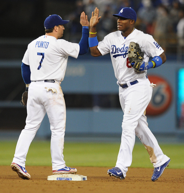. Nick Punto congratulates Yasiel Puig at the end of the game. The Dodgers defeated the New York Mets  4-2 in a game at Dodger Stadium in Los Angeles, CA. 8/13/2013(John McCoy/LA Daily News)
